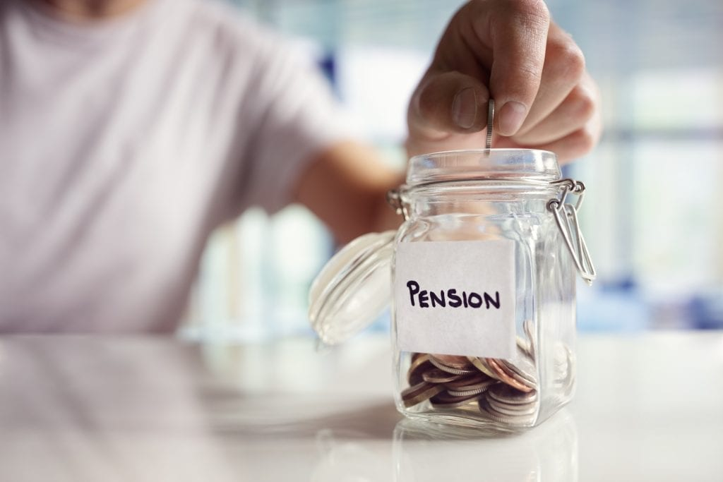 "A man inserts a quarter into a mason jar labeled ""Pension"""